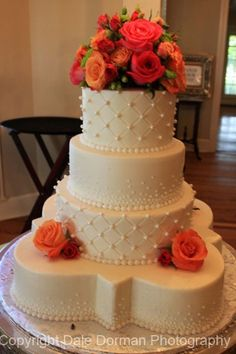 I like the shape of the cake and also the touch of flowers!