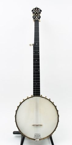 "An early 1900's Philadelphia made SS Stewart Thoroughbred Special appointed with a stunning pianese heel carving, confetti headstock, diamond fret inlays. Newer pancake tuners, and no-knot reproduction tailpiece. Refinished neck and dowel stick, rim and tension hoop have been brought to a brushed finish. All original hardware, including neck bracket. 11"" head, 1 5/32"" nut width, a 26"" scale. Neck slightly bowed, however banjo still plays and sounds."