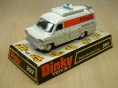 Dinky Toy 287, Ford Transit Accident Unit. This is the first casting of the popular Transit model. This version featured sliding drivers door, twin rear opening doors, a side door, cones and signs & a raisable roof camera, and jewelled headlights. Later versions lacked some of the accessories as budgets grew tight. This model was produced between 1971 and 1974.