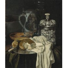English Follower of Pieter Gerritsz. van Roestraeten STILL LIFE WITH A BEER TANKARD, A WINE GLASS, A SILVER VESSEL AND BREAD ON A PEWTER PLATE, WITH OTHER OBJECTS ON A DRAPED TABLE oil on canvas