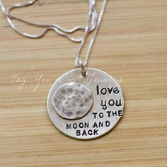 A sweet phrase that's been around for hundreds of years. Perfect gift for a new mommy! This is a one inch sterling silver pendant with a sterling silver moon. MEMBER - Tag You're It Jewelry