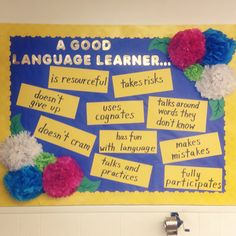Tissue paper flower bulletin board for my Spanish/ESL classroom :)