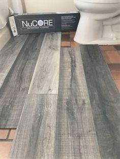 Vinyl plank flooring that's waterproof. Lays right on top of your existing floor. Love this color we're using in our bathroom remodel. #RemodelingApartment
