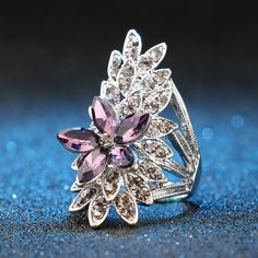 Outfit your hand with a blast of purple color by wearing this GORGEOUS Fashion Crystal Flower Silver Plated Ring! Designed with premium High Quality Material........and you can get it FREE NOW, but only for a limited time at https://www.iglamboutique.com/products/crystalflowerring