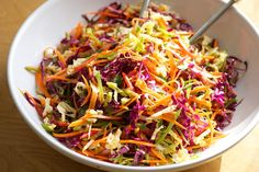 Asian Slaw [with napa & red cabbage, red pepper, carrots, snow peas, green onion, basil, and cilantro]