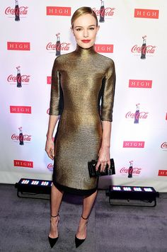 Kate Bosworth wears a metallic gold turtleneck dress with black suede Aquazurra heels