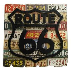 Route 66 License Plate Wall Plaque.  I'm thinking cars and travel should be the theme of the second bedroom.