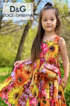 Gorgeous! Dolce & Gabbana girls orange, yello & pink daisy sundress. Taken from the DG Gerbera Floral Theme Women's collection. Soft leather white and red sneakers and a matching daisy leather purse. Perfect special occasion dress. Shop @ Childrensalon (affiliate). See more girls designer party dresses. #dolcegabbana #girlsdress #partydress #childrensalon #dashinfashion Girls Designer Clothes, Designer Party Dresses, Girls Special Occasion Dresses, Girls Dresses, Pink Gerbera, Pink Daisy, Yellow Sundress, Dolce And Gabbana Kids, Holiday Outfits