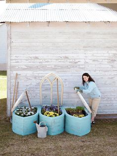 curved bases transform a trio of Gothic-style windows into beautiful, one-of-a-kind cold frames.