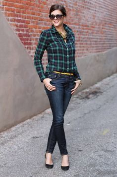 Shop this look on Lookastic: http://lookastic.com/women/looks/sunglasses-necklace-dress-shirt-belt-skinny-jeans-pumps/6004 — Black Sunglasses — Gold Necklace — Navy and Green Plaid Dress Shirt — Yellow Leather Belt — Navy Skinny Jeans — Black Suede Pumps