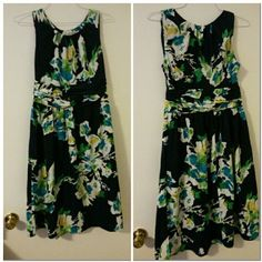 North Style Sleeveless Floral Dress Size 8  NWOT This is a North Style Sleeveless Floral Dress with a scoop neckline and ruching in the midsection.  Dress has tea length flowing bottom. 100% Polyester.   This dress will look great worn alone or with a contrasting blazer blazer. Can be worn to work, school, or church.  No trades. Item is kept in a pet and smoke free environment. If you have any questions please feel free to ask. North Style Dresses