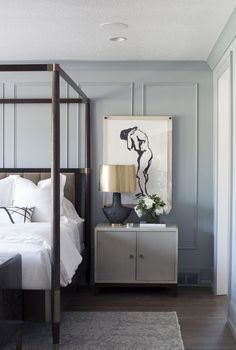 Powder Blue Modern Master Bedroom Design With Dark Canopy Bed And Grey Accents