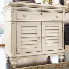 Nightstand with a pull-out shelf and 2 louvered doors.  Product: Nightstand   Construction Material: Wood ...