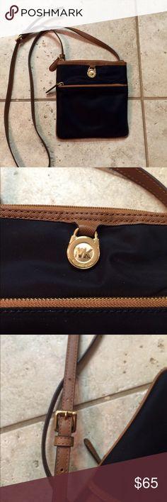 "NWOT MK Kempton Small Pocket Purse 100% Nylon| Gold-Tone Hardware| 9 7/8"" X 1 1/8"" X 10 2/8""| Adjustable Drop: 21""-23""| Exterior: One Zip Pocket, One Open Pocket| Interior: One Zip Pocket, Three Open Pockets| Lining: 100% Nylon KORS Michael Kors Bags Mini Bags"