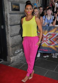 Is it just us or does this bright ensemble remind you of that orange and purple outfit Cheryl wore during her stint on the US X Factor? Having worn mostly black and white to the auditions so far, we're pleased one of the judges is mixing things up a bit (even if we need our sunnies on to look at her)!  -Cosmopolitan.co.uk