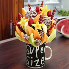 SuperSize Love - Juicy strawberries dipped in milk chocolate with white drizzled, honeydew melon and cantaloupe wedges, grapes and pineapples shaped like small stars. Fruit is picked at the peak of freshness. You can create your own edible fruit arrangements. Price starts from $30  http://www.VaaV.ca