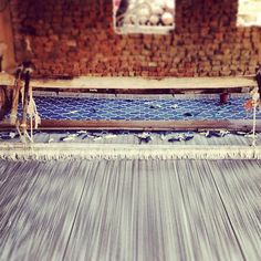One of our designs in the process of being mad eon a hand loom in India. #ecru #blue #prints #jaipur #home