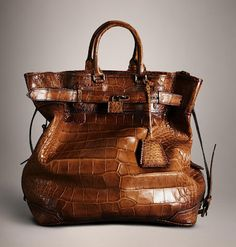Burberry Prorsum - Antiqued Alligator Traveller Bag, $47,000 (Crazy!)   Christopher Bailey took Burberry Prorsum to new heights with the SS13 Menswear Runway Collection. Yes, it's a manbag.