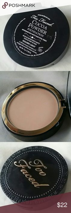 Too Faced *Golden Light* Powder Foundation Too Faced Cocoa Powder Foundation in shade in Golden Light. Has been used a few times, usage shown in pictures. Too Faced Makeup Foundation