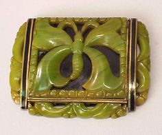 Lot 427 Bakelite and Brass Compact With carved and pierced decoration, stamped Framus made in Austria.  Sold for $700