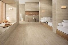 Thanks to the technical properties of porcelain stoneware, Axi brings the charm of wood into venues that require the highest safety standards such as the damp spaces of wellness centres.