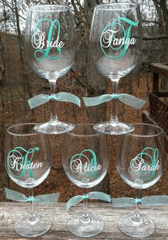 5 Personalized Bridesmaids Wine Glasses by expressandcreate. $50.00 USD, via Etsy.