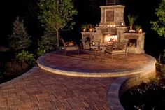 Patio with fireplace with Unilock Il Campo and Fullnose paver
