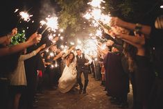 Wedding guests wish the couple well with a tunnel of sparklers. -Angela Renee Photography. See more wedding detail ideas and inspiration at http://angelareneephoto.com/