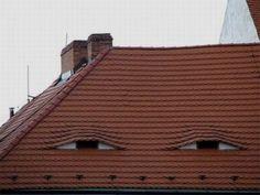 hidden face on building roof