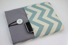 ipad pouch for travel. she can make it to accommodate the smart cover. this might be perfect.  $22.90