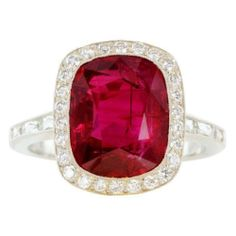 Platinum Solitaire Ring with a 5.03 Carat Ruby with .50 Carats of Full Cut Diamond Accents.