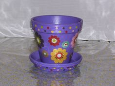 pot luck, clay pots painted and decorated to fit my mood. The flowers and designs are cutouts for scrapbook paper., , Home Decor Project
