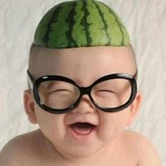 Watermelon hat and thick glasses. Thanks mom.