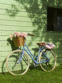 Like the pale lime green siding in this picture…and the bike & blooms, of course!