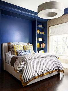 Indigo + Parchment + Gold Impart a rich feeling in your bedroom with color. In this bedroom, indigo blue walls and equally rich espresso-finished wood floors are offset by shades of parchment and cocoa brown. Using gold as an accent color lightens the look, but the elegant tone keeps in step with the room's sophisticated feel.
