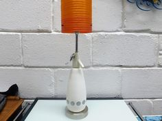 """BOC SPARKLETS - VINTAGE SODA SIPHON TABLE LAMP £38.00  Fab 1970's white with silver spots soda siphon upcycled into a table lamp  Complete with chrome base   New cable, plug and chrome bulb holder  18 1/2"""" High  Beautiful functional, decorative item for the vintage retro lover   All our items are pre-owned and vintage, so may have light signs of use & wear typical of age. A Table, Table Lamp, Decorative Items, Soda, Retro Vintage, Lamps, Chrome, Bulb, Signs"""