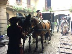 A behind the scenes shot of the Jamie and Claire's carriage and horses in the court. One of the main reasons I wanted to build the courtyard was so that the directors and directors of photography could show Jamie and Claire enter the court and then follow them thru the front door and up the grand staircase and right into their Paris Parlor.