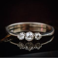 A Daintily Vintage Diamond Delight! Platinum and Diamond Trilogy Engagement Ring  Item #0529 750.00  A quaint little vintage Diamond 'trilogy' engagement ring circa 1930's and completely handmade in platinum marked 'PLAT' in the shank. Perfect as an engagement ring it is hardwearing and as unique as your relationship and each of the three gems are hand-cut and individual each being everso slightly different versions of sparkliness! The Diamonds being cut around 1880's they would have been…