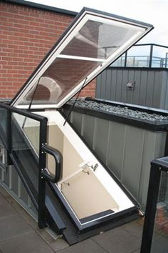 Dayliter Skylights acrylic roof door is available in a variety of shapes, allowing you or your architect to design a door to your roof top patio that is perfect for you! Rooftop Terrace Design, Rooftop Patio, Patio Design, House Design, Roof Access Hatch, Roof Hatch, House Deck, House Roof, Terrazzo