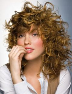 Medium Length Curly Red Hair with Wispy Bangs Hairstyle