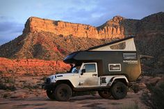 Jeep Action Camper: king-size bed, plenty of storage, a mini-kitchen with three-burner stove and refrigerator, a toilet with optional kitchen sink shower, and a fold-up dining area. #cars