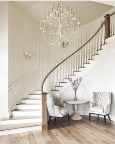At our first meeting with our darling client we talked about her vision for a curved staircase in the entryway. Love how this turned out! Foyer Staircase, Staircase Remodel, Curved Staircase, Staircase Design, Staircases, Stairwell Chandelier, Wrought Iron Staircase, Entryway Stairs, Winding Staircase
