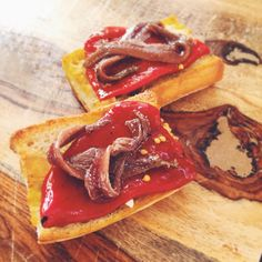 Cantabrian anchovies with piquillo peppers D.O. Lodosa on garlic toast. Anchovies are always getting disrespected. This tapa is out to prove that this is an injustice. Anchovies and piquillos available on donostiafoods.com