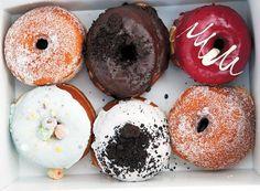 Ottawa SuzyQ donuts Clockwise from top left: Sugar Munkki, Dirty Choclate, Rasberry Cassis, Sugar Munkki, Cookies & Cream, Blue Vanilla Fruit Loop.