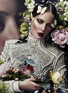 high-flown baroque expectations. Beaded dress and flowers. If I am not mistaken, the top is a Balmain..