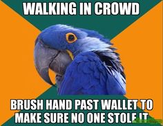 WALKING IN CROWD BRUSH HAND PAST WALLET TO MAKE SURE NO ONE STOLE IT