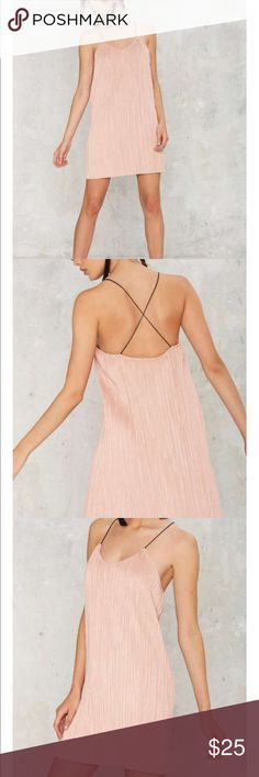 Velvet pink mini dress This dress is made in mauve vegan suede and features a v-neck, black cord skinny straps that cross at back, accordion pleats, and shift silhouette. Unlined.  *Polyester  *Runs true to size  *Model is wearing size S  *Hand wash cold Nasty Gal Dresses Mini