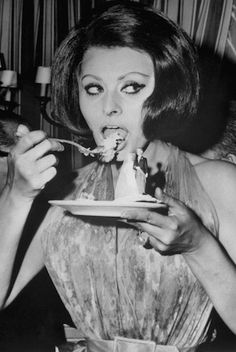 Enjoying a tasty dish, Sophia Loren candidly polishes off the last piece of cake from a saucer decorated with a miniature bride and groom. The treat was part of the Italian actress' latest film,. Get premium, high resolution news photos at Getty Images Sophia Loren, Divas, She Wolf, Italian Beauty, Italian Style, People Eating, Celebrity Pictures, Most Beautiful Women, Old Hollywood