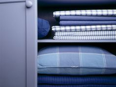 To avoid sorting through individual bed sheets, store sheet sets in bundles. Make a bundle by folding both sheets and all but one pillowcase together, and then tucking the folded linens inside the remaining pillowcase to make a tidy packet. Keep everyday towels, sheets, and other linens front and center, but store infrequently-used items like beach towels, holiday tablecloths, and out-of-season blankets on harder-to-reach shelves. Source: HGTV