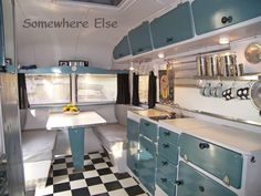 They made an awesome twosome, and the interior of the van was kitted out in 1950s diner style. An interior like this creates its own sunshine. The rig belongs to Roger J. And if you're into vintage caravans, yes that is a Carapark on the edge of the photo above.